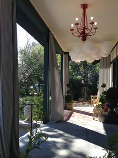 a perfect place out of the sun Porch Garden, Home And Garden, Outdoor Spaces, Outdoor Living, Balcony Curtains, Red Chandelier, House Porch, Cottage Living, Baltimore