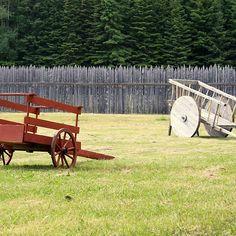 Two Wooden Wheelbarrows