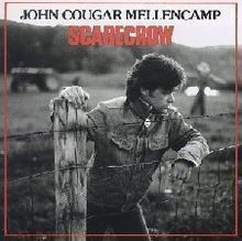 """Johnny Cougar!  My mom owned exactly three cassette tapes.  Scarecrow was one of them, and we listened to it for months at a time.  """"Small Town"""" and """"ROCK in the USA"""" will always take me back to hot hot summers driving around in my mom's red '88 Tercel"""