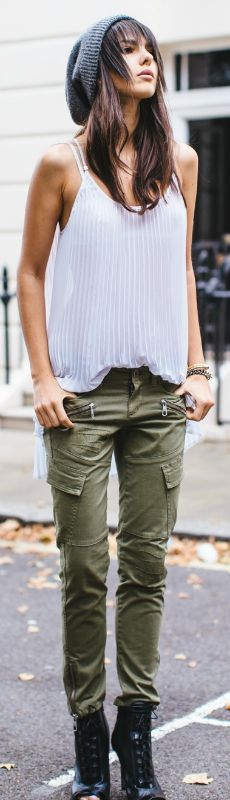 Grab a beanie, a ruffled tank and a pair of military green trousers and you're good to go. Via Doina Ciobanu   Shops: Not Specified