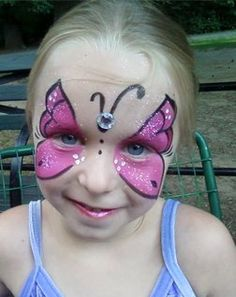 Pink butterfly, face painting. By Hearts Face Painting.