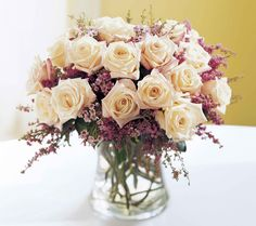 Wedding Flower Arrangements heather looks delicate combined with roses (maybe not my dream bouquet but could consider in the centerpieces!) - A charming bouquet of 18 garden-fresh roses is the perfect way to show your affection. Coral Wedding Flowers, Rose Wedding, Floral Wedding, Diy Wedding, Wedding Bouquets, Fall Wedding, January Wedding, Bridal Flowers, Purple Wedding