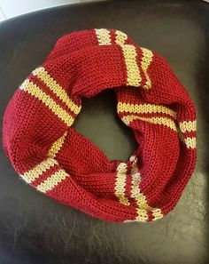 This pattern is for a cowl in the Hogwarts house Hufflepuff colors (you can easily make cowls for the other houses using their appropriate colors). I do not own any rights to Harry Potter or anything related, this is just a fan offering. It is based off of the later years with the small double-stripe pattern seen on the student's scarves.