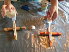 With elatsics, spoons and sticks, kids can make their own catapult and learn a bit about simple machines.