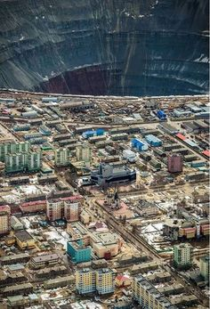 The abandoned Mir Mine diamond pit and the town of Mirny, Sakha Republits, Eastern Siberia, Russia. Mirny Diamond Mine (Siberia). It's an absolute beast and holds the title of largest open diamond mine in the world. The mine is 525 meters (1,722 ft) deep and has a diameter of 1,200 m (3,900 ft), [1] and is the second largest excavated hole in the world, after Bingham Canyon Mine. http://en.wikipedia.org/wiki/Mir_mine