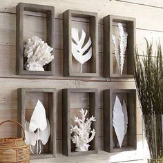 Corral and leaf shadow box sculptures.
