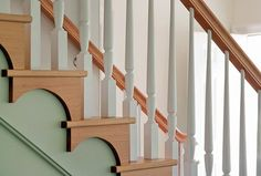 Simple half-circle bracket detailing graces the stairs.