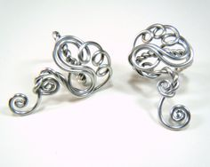 Twisted Sister earcuffs in silver. $15.00, via Etsy.