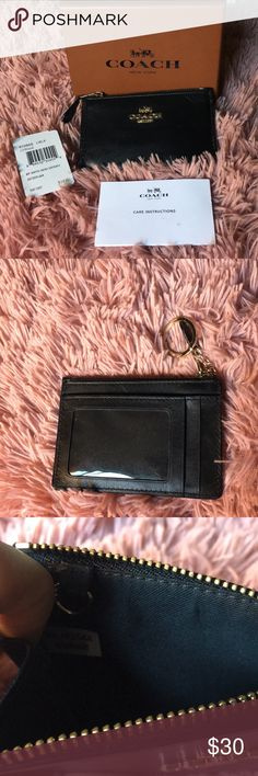 "COACH mini skinny 🌺CLEAR OUT MY CLOSET!!!🌺 Authentic COACH mini skinny ID wallet in black leather with silver hardware. Features zip pocket, 2card slots and one clear ID slot on the back. 4.5"" length x 3.35"" height. Used only a handful of times, light scratches on leather. Coach Bags Wallets"