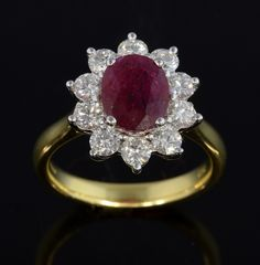 Rubies are a girls best friend... @ewbankauctions Lot 50: Burma ruby and diamond cluster ring, oval cut ruby of 2.28 carats within a surround of ten round brilliant cut diamonds, in 18 ct yellow gold.