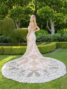 Moonlight Style H1341 Elegant and sophisticated, this Net and Re-Embroidered Lace Appliques Mermaid Wedding Dress from Moonlight Bridal has everything you have been searching for.