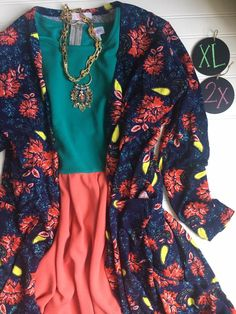 The colors in this LulaRoe outfit are just dazzling. LulaRoe Sarah, LulaRoe Amelia. Get more like this at https://www.facebook.com/groups/LulaRoeKristenD/