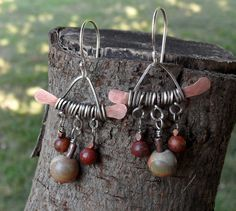 Love these.  Found on Etsy.   Pagoda Hammered Copper Wire Wrapped Silver Red River by 2bwendybee, $25.00