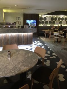 Degani Restaurant, Crown, Melb.  Geometric hexagons on far back wall. Interesting bold flooring pattern. Contrasts with timber look counter tops.