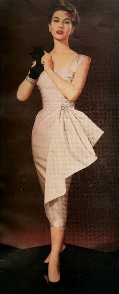 1955 50s pink wiggle dress with hip gather bustle bow color photo print ad model magazine