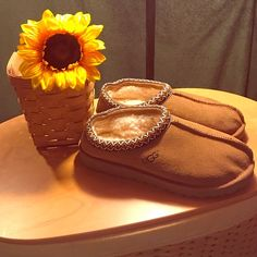 NWOT UGG SLIPPERS NWOT CHESTNUT UGG SLIPPERS. IMMACULATE CONDITION, NO FLAWS. NEVER WORN. PURCHASED DIRECTLY FROM UGG. UGG Shoes Mules & Clogs
