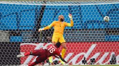 Silvestre Varela of Portugal scores his team's second goal as goalkeeper Tim Howard of the United States looks oncom