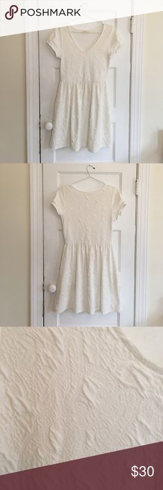 White Everly Dress Knee length white dress with a sewn patterned detail. Worn once. Everly Dresses