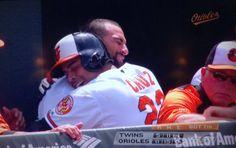 Nelson Cruz giving Nick Markakis a bear hug