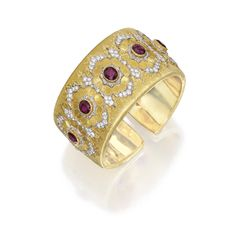 18 Karat Two-Color Gold, Ruby and Diamond Cuff-Bracelet, Buccellati. Of hinged design, set with five oval-shaped rubies weighing ~ 5.50 carats, within frames set with round diamonds weighing ~ 3.45 carats.