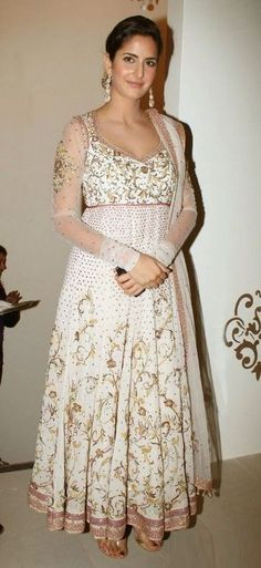 Katrina glitters in this gorgeous gold outfit. We love the pop of colour via the bright lips - As she turns a year older, we bring you images of Katrina Kaif at her glam best - Bollywood Bridal, Bollywood Fashion, Bollywood Actress, Indian Bollywood, Indian Anarkali Dresses, Bridal Anarkali Suits, White Anarkali, Katrina Kaif, Lakme Fashion Week