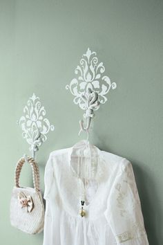 Stenciling turns a decorative hook into functional wall art