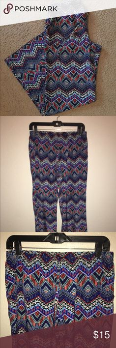Printed Wide Leg Flowy Pants *PRE-LOVED* Colorful, printed wide leg pants with elastic waistband, drawstring & pockets. Super comfy, breathable swishy type material. Great for summer & spring wear with a cute crop top & sandals! Worn twice, no flaws! Ask ❓, more 📸 upon request .. ❌trades ❌holds, ✅bundles, ✅offers using button✌🏾&❤️ BeBop Pants Wide Leg