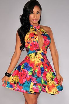 The Multi-Color Floral Print Peep-Hole Halter Flared Dresss is elegant and flirty. It has a comfy and stretchy fit, wear this beautiful dress with your killer heels, and your outfit is on fleek