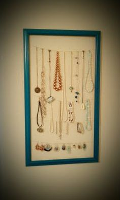 Clever necklace holder. Spray paint a cheap frame from Walmart. Then put fabric behind