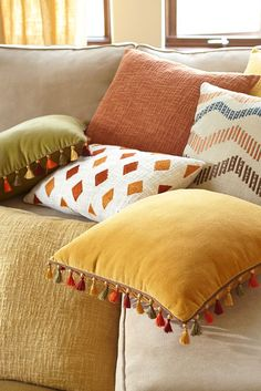 It's said that genius is in the details, and in the case of Pier 1's Malton pillows, we're completely comfortable with that statement. Plush cotton velvet covers the front, while a matching cotton back secures its place on sofas and chairs. But the real story here: Colorful hand-tied tassels that add texture and movement to the entire design. Genius, indeed.