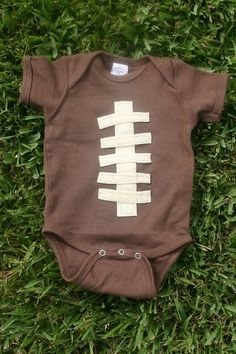 Baby Football Onesie~ my dad used to say he carried me like a football and that's why I can throw a spiral so well :) so getting this for the next baby in the family
