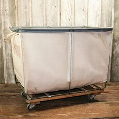 Vintage Canvas Laundry Cart  $189  Reminds me of a prison laundry basket...not that I would know