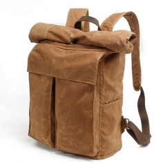 This is a classic army rolltop rucksack. It made from waxed canvas.  Top roll closure; Two external front flap pockets; Two external side slip pockets; Top leather handle; The main compartment has lined with a simple laptop sleeve, a backwall zip pocket.  Size: w33CM, H50cm, D15cm.