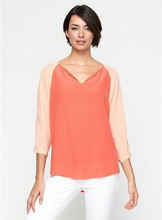 This lightweight blouse has very simply styling with interest from raglan sleeves. Color-Blocked Ballet Slit Neck Top in Silk Crepe de Chine #eileenfisher