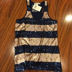 Sparkling blue and gold tank This beautiful tank top is covered in navy blue and rose gold sequins. Brand new with tags and extra sequins Boston Proper Tops Blouses