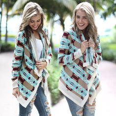 AMAZING PRINT!! This super comfy Navy And Coral Cardigan is an absolute MUST HAVE! It's both colorful and stylish - making it a perfect option for the upcoming fall/winter season. Pair with any of our casual tops for a truly cute outfit! We have many more awesome cardigans at our online boutique!