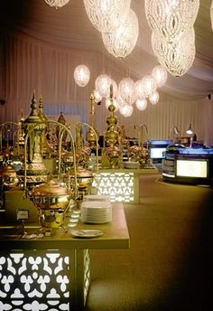 A lavish buffet offering an extensive range of Arabic delicacies and family favorites, complimented by international cuisines and live cooking stations.