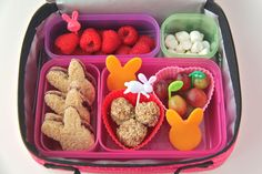 This bento lunch was Bunny themed! It includes fresh raspberries with a bunny pick, bunny-shaped homemade blueberry jam sandwiches (with homemade blueberry jam–again!), bunny-shaped organic Applegate cheddar cheese slices, a few No-Bake Energy Bites with a bunny pick (recipe here) made with almond butter, grapes with leaf and stem picks, and a small portion of mini marshmallows for something sweet.