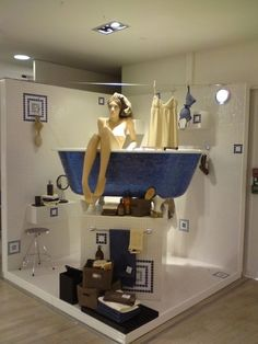 a seated mannequin in the bathtub is a great way to sell bath products