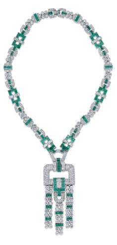 AN ART DECO EMERALD AND DIAMOND PENDENT NECKLACE, 1930S. The openwork diamond-set pendant with calibré-cut emerald and baguette-cut diamond line accents suspending three emerald and diamond-set lines of geometric design, to the similarly-set necklace, pendant detachable for wear as a brooch, pendant 7.2 cm, necklace 37.0 cm, with French assay mark for platinum and gold.