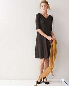 Eileen Fisher. I'm so tired of wearing snug, fitted uncomfortable clothes.