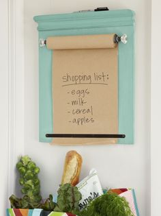 DIY TO-DO LISTEasy instructions to make your own wall-mounted shopping list We made ours by topping a piece of ½-inch plywood with chair-rail molding, which we finished with decorative ends using a coping saw. A roll of kraft paper spins on a wood.