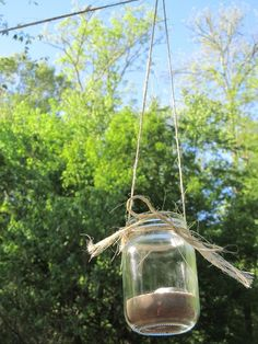 Easy Hanging Tea Light Holder - just put the tops on the jars when you're done to keep the rain out. :)