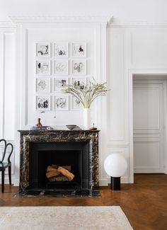 Big impact art and lighting in neutral tones make this room oh so chic