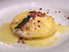 Raviolo al Uovo recipe from Anne Burrell via Food Network. Ravioli stuffed with ricotta and a soft egg yolk.