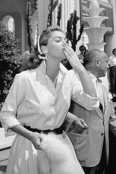 The Glamorous Women of Vintage Cannes - Esther Williams, 1955  The famous American swimmer and actress blows a kiss in a button-down blouse and flouncy skirt.