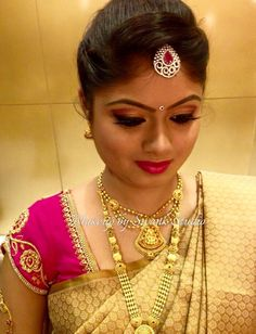 Golden vibes. Our would-be bride Navyashree looks like a vision in gold and pink attire for her engagement. Makeup and hairstyle by Swank Studio. Pink lips. Eyebrows. Bridal jewelry. Maang tikka. Bridal hair. Silk sari. Bridal Saree Blouse Design. Indian Bridal Makeup. Indian Bride. Gold Jewellery. Statement Blouse. Tamil bride. Telugu bride. Kannada bride. Hindu bride. Malayalee bride. Find us at https://www.facebook.com/SwankStudioBangalore