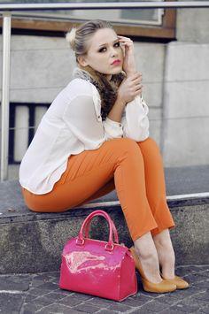 orange pants and pumps with chiffon blouse