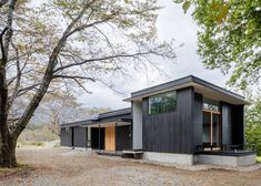 Blackened timber retreat by Studio Aula built in the woods near Tokyo.