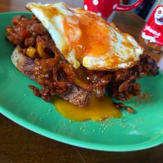Spipcy chorizo & lentil stew leftovers - smashed on top of a toasted piece of buttery vogels & topped with e fried egg, Lucky Taco Chilli Salt & Habanero Hot Sauce! GAH!